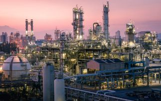 Petrochemical plant or oil and gas refinery industry at evening time Factory of petroleum industrial with sunset sky